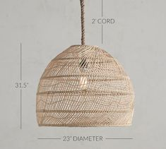 Woven of natural materials, the Flora Rattan Pendant adds softly diffused light to a room. A rope cord and bronze-finished frame complement the look of this lighting – a perfect choice for any space, whether a master bedroom or a small se Rattan Light Fixture, Rattan Pendant Light, Dining Room Light Fixtures, Kitchen Pendant Lighting, Pendant Light Fixtures, Dining Lighting, Pottery Barn Pendant Lights, Scandinavian Pendant Lighting, Rattan Lamp