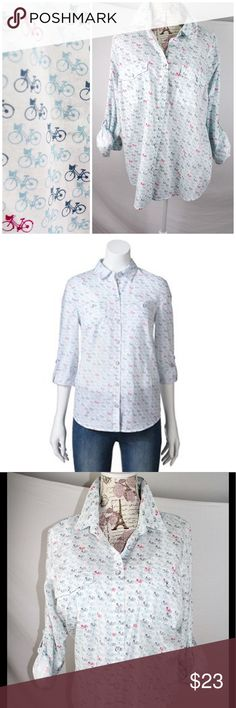 """White Roll-tab Camp Shirt Bicycle Print 1X Roll-tab Camp Shirt with 🚴 Bicycle Print in white, size 1X. """"Expand your everyday wardrobe with this women's SONOMA Life Styles shirt. Its soft cotton construction and roll-tab sleeves give you casual comfort. Product Features * Button front * Sleeves roll from long to 3/4-length * 2-chest pockets Fabric & Care * Cotton * Machine wash"""".  Pre-owned in unworn condition.  Clean, ready to wear! Sonoma Tops Button Down Shirts"""