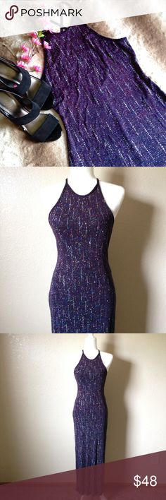"""High Neck Holographic Glitter Slip Gown Absolutely stunning slip gown from Jump Apparel, features all over holographic glitter, high neck, cross back, low open back, back slit and a slight purple to navy blue gradient on the fabric. Great gently used condition, size 5/6 but could fit larger since it's very stretchy. ---- Approximate measurements when relaxed are; 29"""" bust, 25"""" waist, 30"""" hips and 53.5"""" total length. ---- I happily entertain reasonable offers  Jump Dresses Prom"""