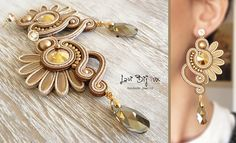 Handmade italian jewerly. Each creation is a unique piece made with top quality materials. ITEM DETAILS: -Colors: gold, beige, brown -Materials: soutache string, beads, Swarovski elements -Size: 10,5 cm. -Back: finished with artificial leather. -Earring Material: brass. Come to see