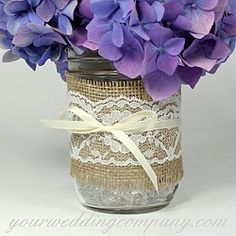 Rustic hydrangea centerpiece with scalloped white lace, satin ribbon and natural burlap.