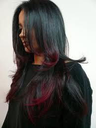 Dark brown hair with red tips