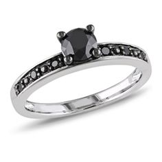 Radiance and sparkle define this eye-catching diamond ring. Expertly crafted in sleek sterling silver, this ring showcases a 3/4 ct. enhanced black diamond in a traditional four-prong setting. Smaller enhanced black diamonds adorn the ring's shank, completing the design. A new take on a classic design, this ring captivates with 7/8 ct. t.w. of diamonds and a polished shine. Custom made to fit her ring size. Sterling silver rings cannot be resized after purchase.