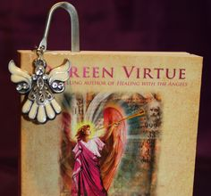 Let the Angels safely keep the page in your book. This shepherd's hook bookmark nestles inside your book with the Angel gently dangling on the outside. The little box makes it the perfect gift for book lovers!