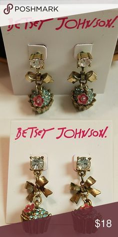 Gorgeous Betsey Johnson cupcake earrings Gorgeous Betsey Johnson brass tone blue pink with bows cupcake earrings. I am sorry but I am firm with this price . thank you of course you can always bundle to save on money Betsey Johnson Jewelry Earrings