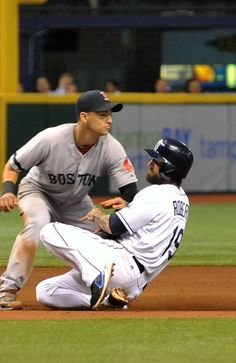 ST. PETERSBURG, FL - JUNE 11: Infielder Jose Iglesias #10 of the Boston Red Sox tags sliding infielder Ryan Roberts #19 of the Tampa Bay Rays during a pickoff June 11, 2013 at Tropicana Field in St. Petersburg, Florida. (Photo by Al Messerschmidt/Getty Images)