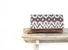 We create our everyday clutch collection from upscale textiles and aged…