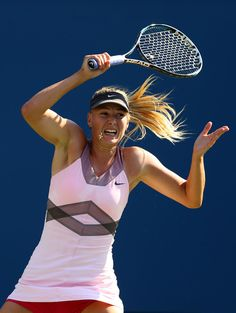 Maria Sharapova of Russia returns a shot against Mallory Burdette of the United States during their women's singles third round match on Day Five of the 2012 US Open