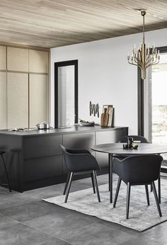 Susanna Vento for Kannustalo. Minimalist kitchen and dining.