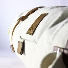 CULT OF ONE scout duffel bag, side profile with leather branding patch and canvas