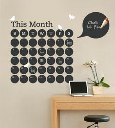 A perpetual calendar wall decal in black chalkboard vinyl makes it easy to write on and erase.