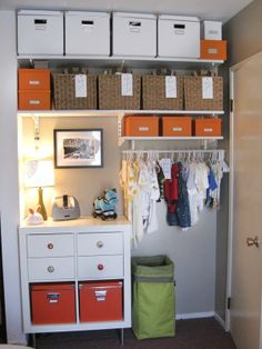 Organized baby's closet with baskets, boxes and labels - oh my!