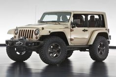 Jeep® Wrangler Flattop: 1 of 6 special edition concepts developed for 47th Annual Moab Easter Jeep® Safari. Featuring a custom one-piece, windowless hard top, the body is finished in a metallic sandstone with copper and brown accents. The top and windshield were chopped two inches, and the b-pillar was removed creating a massive opening from front to rear. #Jeep #Moab #Wrangler