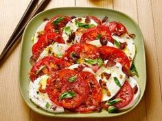 Pancetta Caprese (No. 39) : Arrange fresh mozzarella and sliced tomatoes on a plate. Drizzle with olive oil and white wine vinegar. Sprinkle with salt, pepper, crumbled cooked pancetta and torn basil.