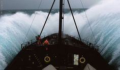 #Photography This boat crashing into a wave in stormy waters captures a scary moment in time, especially for the crew.
