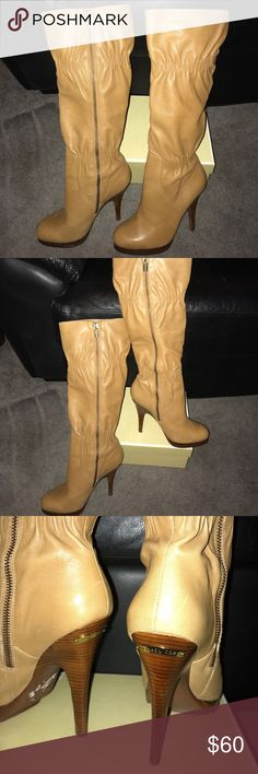 Michael Kors genuine leather boots These stylish genuine leather boots will accentuate any outfit! They are a soft tan leather with gold tone Michael Kors accents on the heels of the boot and on the zipper pull. Worn only once, they would look great dressed down with a pair of jeans or dressed up for a nite in the town.💕 Please see picture #7, light scrape on the side of the boot.  Other than that, they are in excellent condition. MICHAEL Michael Kors Shoes Heeled Boots