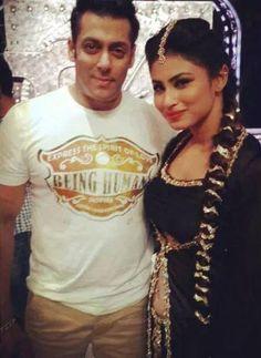 Salman Khan smiles for a picture along with 'Devon Ke Dev...Mahadev' actress Mouni Roy while promoting 'Kick' #Style #Bollywood #Fashion #Beauty