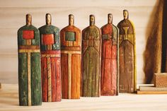 Saints carved from reclaimed wood and hand-painted by artisans in Guatemala.