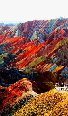 Danxia Landform at Nantaizi village of Nijiaying town, in Linzhe county of Zhangye, Gansu province of China. Danxia landform is formed from red-coloured sandstones and conglomerates of largely Cretaceous age. Places Around The World, The Places Youll Go, Places To See, Zhangye Danxia Landform, Beautiful World, Beautiful Places, Amazing Places, Amazing Photos, Wonderful Places