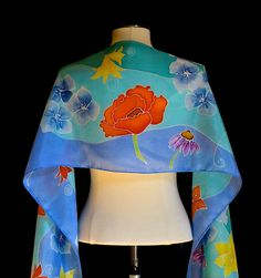Silk scarf, hand painted delicate yet vibrant flowers on a field of blue and turquoise  14x72 inches  Ready to ship - pinned by pin4etsy.com