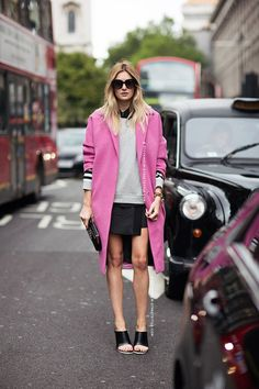 Spring in London with a pink coat and quilted skirt.