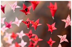 Beautiful red origami cranes to match cherry blossom decor