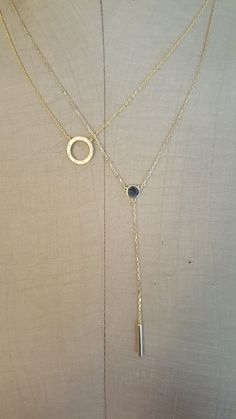 Gold colored necklace and pendant.