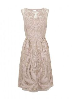 Love the design on this lace dress
