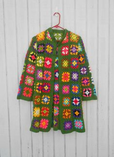 Vintage 70's Sweater Jacket Crocheted Small Jacket Granny Square Hippie Bright Neon Coat. $37.00, via Etsy.
