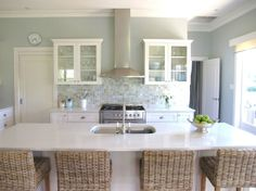 Pretty and clean...fan of this kitchen!.