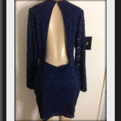New Victoria's Secret Navy Lace Open Back Dress XL Brand new VS navy blue lace open back long sleeve dress in size XL. Beautiful dress perfect for the upcoming season. This was an online order so it does not have any tags attached. Pictures definitely do it no justice! Does seem to run a little small also. Victoria's Secret Dresses Midi