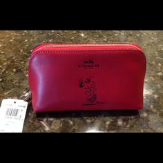 "Limited Edition Snoopy Coach Cosmetic Case COACH limited edition Snoopy collection red cosmetic case.  Designed with Snoopy embossed on the front side.  Zip closure, fabric lined interior with a multi purpose pocket on one side.  This is perfect for Snoopy collectors!!  6.75"" x 3.5"" x 3.75"" high.  Comes with Coach gift bag.  No Trades Coach Bags Cosmetic Bags & Cases"