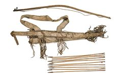 Apache bow and quiver set -  sinew-sewn buffalo hide with red painted decorations and hide drops with circular cutouts, length 40 in. Also included is a sinew-backed bow, length 44 in. AND eight metal-tipped arrows with red and blue pigment, average length 23 in. fourth quarter 19th century