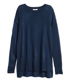 Dark blue. Long sweater in a soft, fine knit. Dropped shoulders, long sleeves, and slits at sides. Slightly longer at back.