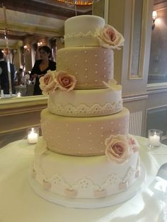 Blush wedding cake #embroidery #eyelet #pinkroses