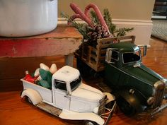 vintage toy trucks decorated for Christmas...I'll have to do this with mine! :)