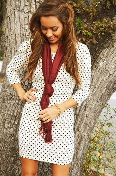 Love. Polka dot dress with deep red scarf