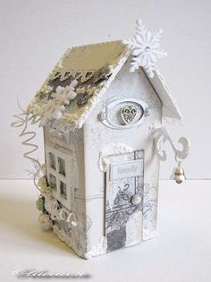 A winter house. It's a MAya Road chipboard house with a mini album inside (the roof can be removed. Christmas Village Houses, Christmas Town, Putz Houses, Christmas Villages, Bird Houses, Christmas Crafts, Christmas Decorations, White Christmas, Cardboard Paper