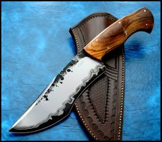 Don't like the style of the blade, but love the design on it.