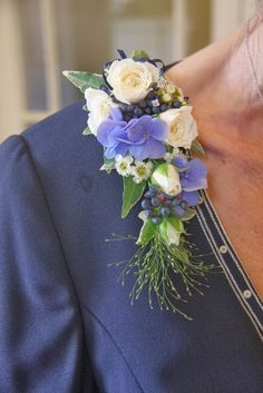 The Groom's Mum's Corsage looked perfectly matched to the blue of her jacket