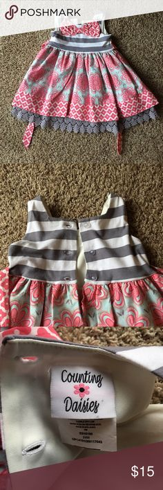 24 month dress Wonderful dress for spring pictures of your little one! Beautiful color combo of pink, blue and grey. Bodice is cotton and spandex, which makes for a very comfortable wear. Skirt is 100% cotton. Only worn once. Excellent condition! Counting Daisies Dresses Casual