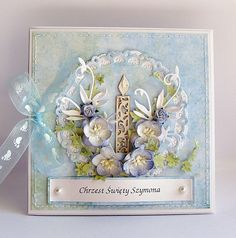 gorgeous card in blues with a candle die cut...probably a christening card...tiny footprints on the sheer ribbon bow...