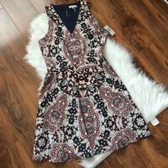 1. State floral dress Perfect party dress or everyday dress! Lovely cut out in the back. Offers welcome through offer tab. No trades. 1. STATE Dresses Mini