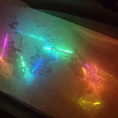 Glow sticks in the bath with bubble bath...my son Loooves this! Wish this idea was around when I was little.