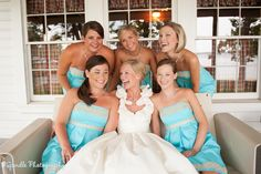 love everything.. the wedding dress, bridesmaid dresses. EVERYTHING