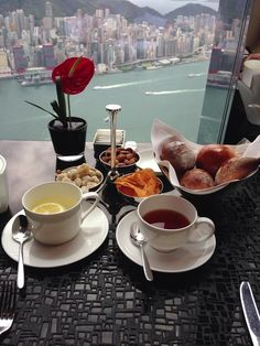 Luxurious afternoon snacks high above #HongKong's world-renowned skyline - @The Ritz-Carlton