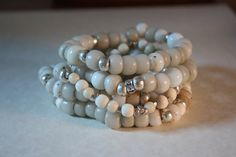 handmade: bracelets of antique African trade beads, vintage milk glass, and silver