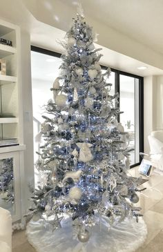 Flocked Christmas tree by Rachel Pihakis of Pathfinder Group Inc.  All white, silver and clear ornaments.