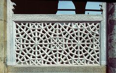 Image TUR 0215 featuring latticework from the Green Mosque, in Iznik, Turkey, showing Geometric Pattern using carved masonry or stone relief.
