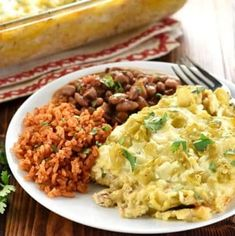 Salsa verde, green chiles, and a creamy homemade sauce make this stacked Chicken Enchilada Casserole as delicious as the original without all the work! Green Chicken Enchilada Casserole, Green Chicken Enchiladas, Chicken Casserole, Casserole Recipes, Mexican Food Recipes, Ethnic Recipes, Homemade Sauce, Avocado Salad, Chicken Recipes